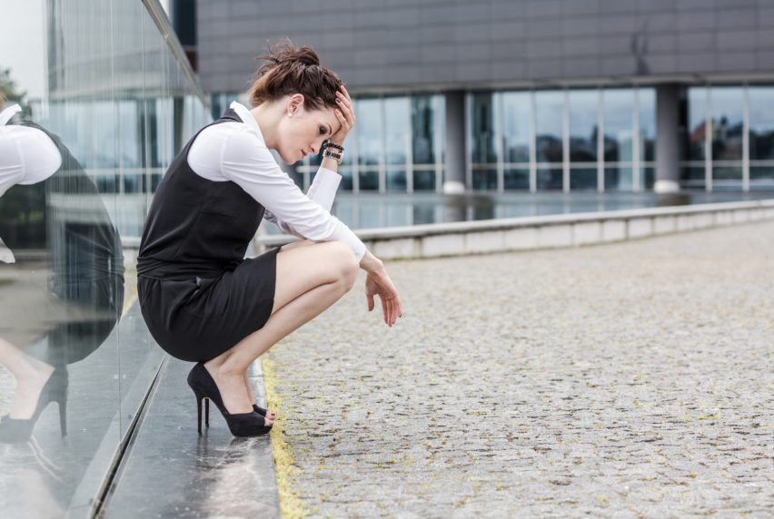 Tired or Depressed Businesswoman Outside